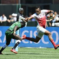 Kameli Soejima avoids a tackle by a Kenyan player to score a try during their Rugby World Cup Sevens match on Sunday at AT&T Park in San Francisco.   KYODO