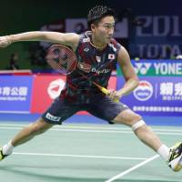 Kento Momota competes against Ukraine's Artem Pochtarov in the first round at the World Badminton Championships on Tuesday in Nanjing, China. Momota won 21-13, 21-12. | KYODO