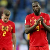Belgium's Romelu Lukaku (right) and Toby Alderweireld leave the pitch following their semifinal loss against France at the World Cup on Tuesday in St. Petersburg, Russia. | AP