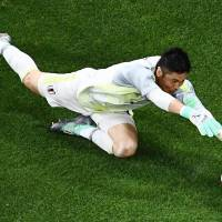 Japan's goalkeeper Eiji Kawashima catches the ball during the Russia 2018 World Cup round of 16 football match between Belgium and Japan at the Rostov Arena in Rostov-On-Don, Russia, on Monday.   AFP-JIJI