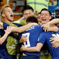 Japan's Takashi Inui celebrates after the team scored its second goal in its World Cup match against Belgium at Rostov Arena, Rostov-on-Don, Russia, on Monday.   REUTERS