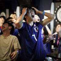 Japanese fans react after second goal by Belgium as they watch a broadcast of the World Cup Round of 16 soccer match Belgium vs. Japan at a sports bar in Tokyo on Tuesday.   REUTERS