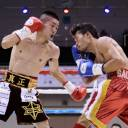 Ryuya Yamanaka (left) fights against Vic Saludar of the Philippines in their WBO minimumweight title bout on Friday in Kobe.