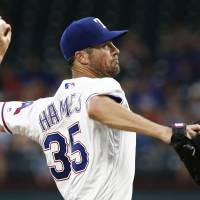 Rangers southpaw Cole Hamels is seen pitching on Monday before being traded to the Chicago Cubs on Friday. | AP