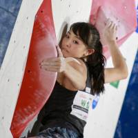 Climbing prospect Futaba Ito performs in a bouldering competition at the Combined Japan Cup in Morioka. | KAZ NAGATSUKA
