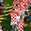 The Croatian players are congratulated by the French team following their match on Sunday in Moscow.