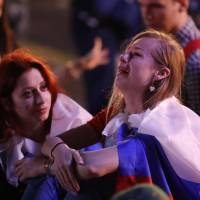 Russia fans react after their team lost to Croatia in quarterfinals on Saturday. | REUTERS