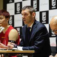 Former Toyama Grouses head coach Miodrag Rajkovic (center), seen during a news conference in May, has been hired to lead the Nishinomiya Storks. | B. LEAGUE