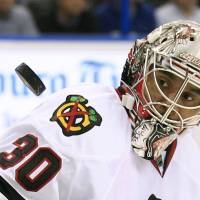Blackhawks goalie Ray Emery watches the puck during a game against Lightning on Nov. 4, 2011, in Tampa, Florida. Emery died on Sunday at age 35. | AP