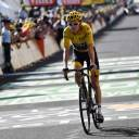 Tour de France leader Geraint Thomas crosses the finish line during the 14th stage on Saturday in Mende, France.