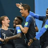 France's (from left) Antoine Griezmann, Samuel Umtiti, Raphael Varane and Paul Pogba celebrate after scoring against Belgium during the second half on Tuesday. | AP