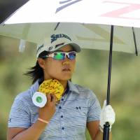 Nasa Hataoka tries to keep cool during the third round of the Women's PGA Championship on Saturday in Kildeer, Illinois. | USA TODAY / VIA REUTERS