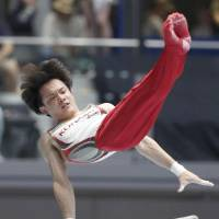 Yusuke Tanaka performs on the parallel bars on Sunday at the national apparatus championships in Takasaki, Gunma Prefecture. | KYODO