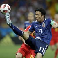 Japan captain Makoto Hasebe controls the ball during his team's round-of-16 game against Belgium at the 2018 World Cup in Rostov-on-Don, Russia, on Monday. | AP