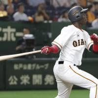 The Giants' Jorge Martinez homers in the second inning. He signed a regular contract a few hours before the game. | KYODO