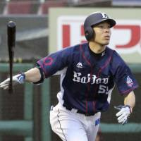 Seibu's Shogo Akiyama hits a solo home run in the 11th inning of the Lions' 4-3 win over the Eagles on Sunday. | KYODO