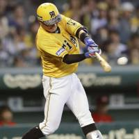 The Tigers' Fumiya Hojo hits a one-out single in the third inning against the Carp on Wednesday night at Koshien Stadium. Hanshin defeated Hiroshima 6-3. | KYODO