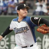 Fighters starter Kohei Arihara delivers a pitch against the Marines on Tuesday. Arihara tossed eight shutout innings. | KYODO