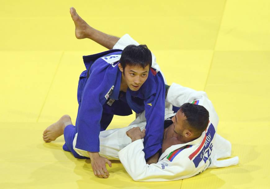 Naohisa Takato (left), seen in a file photo from the World Judo Championships in August 2017 in Budapest, earned the men's 60-kg title on Friday at the Zagreb Grand Prix, a three-day weekend event. | AFP-JIJI