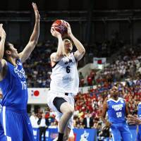 Japan's Makoto Hiejima takes a jumper in first-quarter action against Taiwan on Monday night in a FIBA Wold Cup Asian qualifier in Taipei. Hiejima scored 17 points in  Japan's 108-68 victory. | KYODO