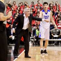 Japan coach Julio Lamas provides instructions to his players from the sidelines during the team's game against Taiwan in the FIBA World Cup Asian qualifiers in Yokohama in February. | KAZ NAGATSUKA