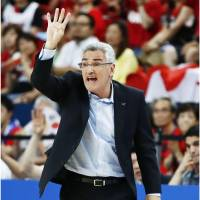 Japan bench boss Julio Lamas shouts instructions to his players on Monday night. | KYODO