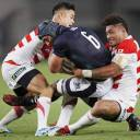 Japan's Amanaki Lelei Mafi (right) is seen in action against Scotland in a June 2016 test match. He also plays for the Melbourne Rebels, a Super Rugby club.