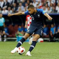 France's Kylian Mbappe scores a goal in the World Cup final on July 15. | REUTERS