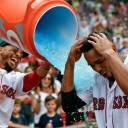 Red Sox outfielder Mookie Betts pours Gatorade on Xander Bogaerts after their walk-off win over the Blue jays on Saturday at Fenway Park. Bogaerts lifted the Red Sox with a 10th-inning home run.