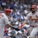St. Louis' Matt Carpenter (right) is greeted by teammate Yadier Molina after Carpenter's home run against Chicago in the first inning on Friday.
