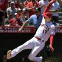 The Angels' Shohei Ohtani slides home to score during the second inning of Los Angeles' victory over the Astros on Sunday.