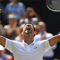 Serbia's Novak Djokovic celebrates after beating Japan's Kei Nishikori 6-3, 3-6, 6-2, 6-2 during their men's singles quarter-finals match on the ninth day of the 2018 Wimbledon Championships at The All England Lawn Tennis Club in Wimbledon, southwest London, on Wednesday. | AFP-JIJI