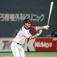 Nippon Ham's Go Matsumoto drives in the Fighters first run with an RBI double in the first inning on Saturday at Sapporo Dome. | KYODO