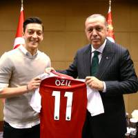 Mesut Ozil quits Germany squad after criticism over photo with Turkish president