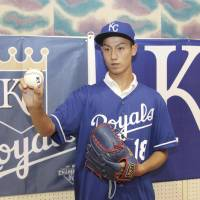 Sixteen-year-old pitcher Kaito Yuki poses for a picture in Osaka Prefecture on Sunday after signing a minor league deal with the Kansas City Royals. | KYODO