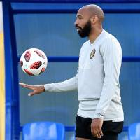 French soccer legend Thierry Henry is serving as an assistant coach for Belgium during this year's World Cup in Russia. Belgium will face France in the semifinals on Wednesday. | AFP-JIJI