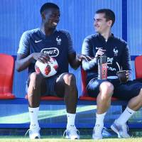France's Paul Pogba (left) and Antoine Griezmann sit on the bench during a training session in Istra, Russia, on Friday. France will play Croatia in the World Cup final on Sunday in Moscow. | AFP-JIJI