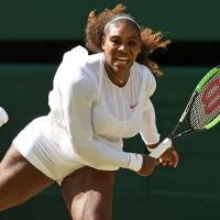 Serena Williams competes against Camila Giorgi during their quarterfinal match at Wimbledon on Tuesday. | AFP-JIJI