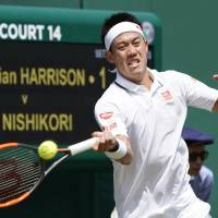 Kei Nishikori competes against Christian Harrison in a first-round match at Wimbledon on Tuesday. Nishikori won 6-2, 4-6, 7-6 (7-3), 6-2. | KYODO