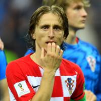Croatia's Luka Modric looks dejected after his team fell to France Sunday in the World Cup final in Moscow. | REUTERS