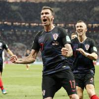 Croatia's Mario Mandzukic celebrates after scoring his side's second goal during the semifinal match between Croatia and England at the 2018 soccer World Cup in the Luzhniki Stadium in Moscow Wednesday. Croatia won 2-1. | AP