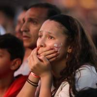 An England soccer fan reacts after England lost the semifinal match between Croatia and England at the 2018 soccer World Cup, in Hyde Park, London, Wednesday. | AP