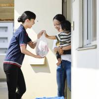 A Coconet Co. employee delivers groceries to a customer. | COCONET CO.