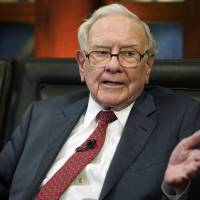 Berkshire Hathaway Chairman and CEO Warren Buffett speaks during an interview in Omaha, Nebrask, in May with Liz Claman on Fox Business Network's 'Countdown to the Closing Bell.' Buffett says stocks remain attractive investments even at today's high prices when compared to bonds or real estate. | NATI HARNIK / VIA AP