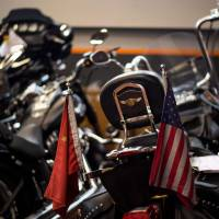 Chinese and U.S. flags adorn a Harley-Davidson motorcycle at a dealership in Shanghai on Friday. | AFP-JIJI
