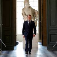 French President Emmanuel Macron walks through the Galerie des Bustes (Busts Gallery) to access the Versailles Palace's hemicycle to address both the upper and lower houses of the French parliament (National Assembly and Senate) at a special session in Versailles near Paris July 9. | REUTERS
