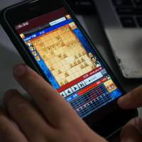 Heroz Inc. released its 'Shogi Wars' game in 2012, and its stocks prices have soared since its April debut on the Tokyo Stock Exchange's Mothers index. | BLOOMBERG