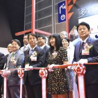 Agriculture, Forestry and Fisheries Minister Ken Saito (front, third from left) attends the opening ceremony of the Japan pavilion at Food Expo 2018 in Hong Kong on Thursday. | KYODO