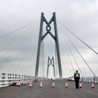 Media reporters were given a preview of the Hong Kong-Zhuhai-Macao Bridge, a 55 km span that connects Hong Kong and the Chinese mainland, in November 2017. Some Hong Kong residents are worried the bridge could undermine the high-level autonomy promised by Beijing before the 1997 handover. | KYODO