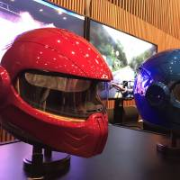Prototype smart helmets made by Japan Display Inc. are exhibited on Wednesday in Tokyo's Akihabara district. | KAZUAKI NAGATA